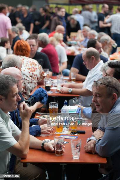 Attendees enjoy and taste different types of beer across Britain at the Great British Beer Festival in Olympia London Keningston London organised by...