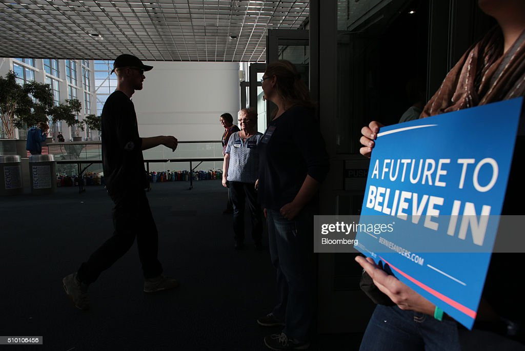 Attendees enter a campaign event for Senator Bernie Sanders, an independent from Vermont and 2016 Democratic presidential candidate, at the Colorado Convention Center in Denver, Colorado, U.S., on Saturday, Feb. 13, 2016. In the first Democratic debate on Thursday since her crushing defeat in New Hampshire, Hillary Clinton tried a new approach to win back wavering supporters, capturing Bernie Sanders anger without looking angry. Photographer: Matthew Staver/Bloomberg via Getty Images