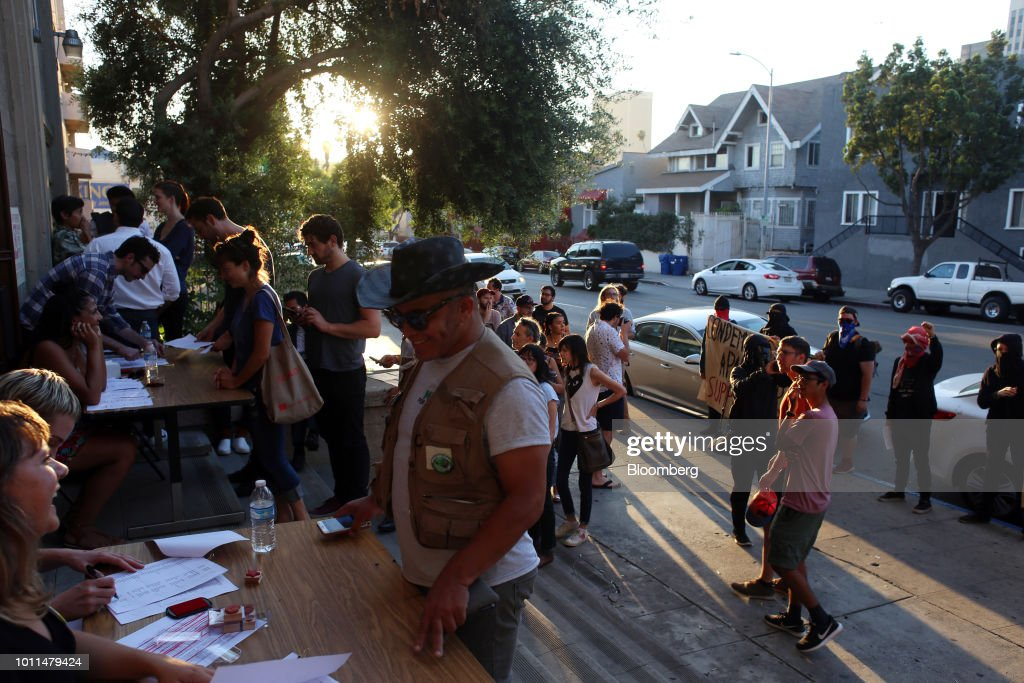 Attendees enter an event for Alexandria Ocasio-Cortez, Democratic U.S. Representative candidate from New York, at the First Unitarian Church of Los Angeles in Los Angeles, California, U.S., on Friday, Aug. 3, 2018. Ocasio-Cortez campaigned on abolishing ICE en route to her stunning upset primary victory in a New York City district against a top House Democrat. Photographer: Dania Maxwell/Bloomberg via Getty Images