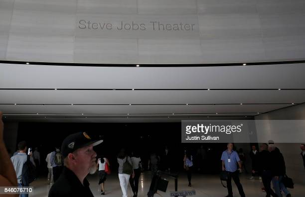 Attendees enter the Steve Jobs Theatre for a special event at Apple Park on September 12 2017 in Cupertino California Apple is holding their first...
