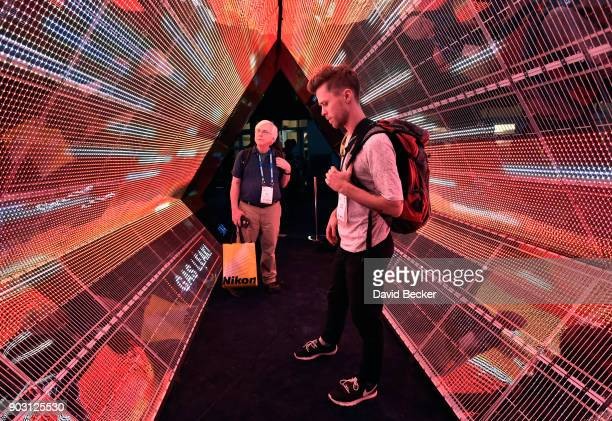 Attendees examine a 5G immersion display at the Intel booth during CES 2018 at the Las Vegas Convention Center on January 9 2018 in Las Vegas Nevada...