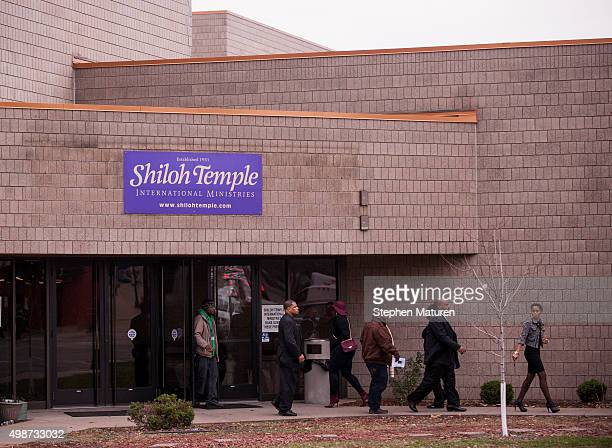 Attendees exit the funeral service of Jamar Clark at Shiloh Temple on November 25 2015 in Minneapolis Minnesota Activists are keeping up pressure for...