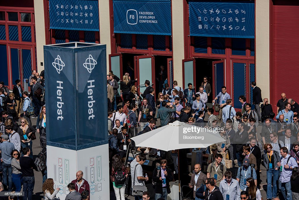 Attendees exit the Herbst Pavilion after the keynote address during the Facebook F8 Developers Conference in San Francisco, California, U.S., on Wednesday, March 25, 2015. Facebook Inc. is opening up its Messenger chat application, letting developers create software for people to add photos, videos and other enhancements to their online conversations. Photographer: David Paul Morris/Bloomberg via Getty Images