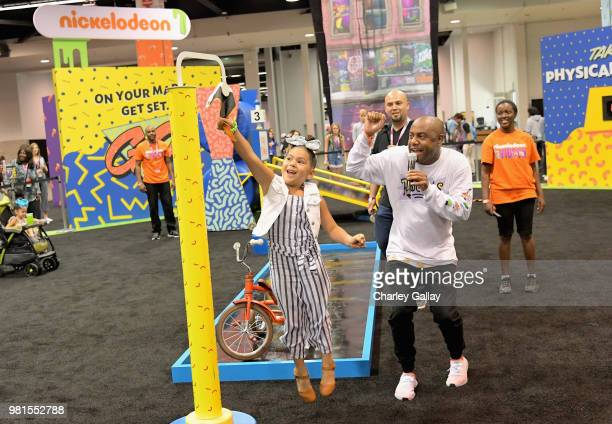 Attendee's experience the Double Dare obstacle course at Nickelodeon's booth at 2018 VidCon at Anaheim Convention Center on June 22 2018 in Anaheim...