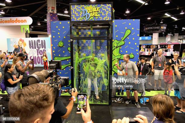 Attendees experience the Double Dare obstacle course at Nickelodeon's booth at 2018 VidCon at Anaheim Convention Center on June 22 2018 in Anaheim...