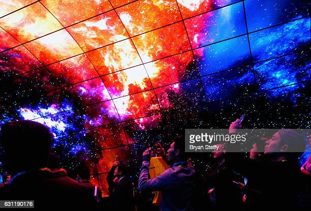 Attendees experience the LG OLED 4K activation at CES 2017 at the Las Vegas Convention Center on January 7 2017 in Las Vegas Nevada CES the world's...