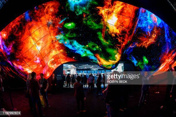 Attendees experience the LG OLED Wave made up of 200 55inch LG OLED digital screens January 10 2020 on the final day of the 2020 Consumer Electronics...
