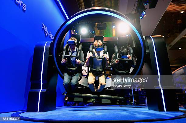 Attendees experience the Samsung Gyro VR Simulator at CES 2017 at the Las Vegas Convention Center on January 7 2017 in Las Vegas Nevada CES the...