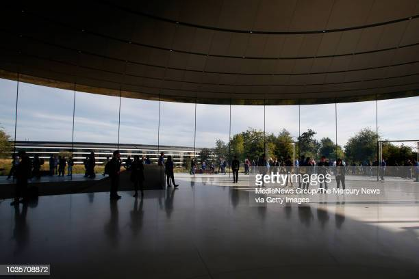 Attendees for Apple's product launch event mill in the Steve Jobs Theatre Wednesday Sept 12 at Apple headquarters in Cupertino Calif
