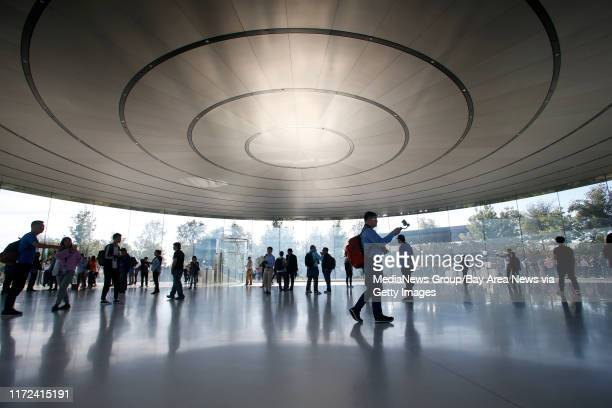 Attendees for Apple's product launch event mill in the Steve Jobs Theatre, Wednesday, Sept. 12 at Apple headquarters in Cupertino, Calif.