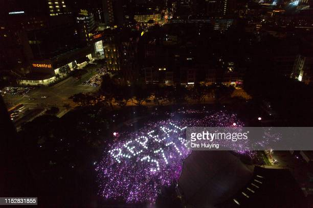 Attendees form the characters Repeal 377A in a call to repeal Section 377A of Singapore's Penal Code which criminalises sex between men during the...