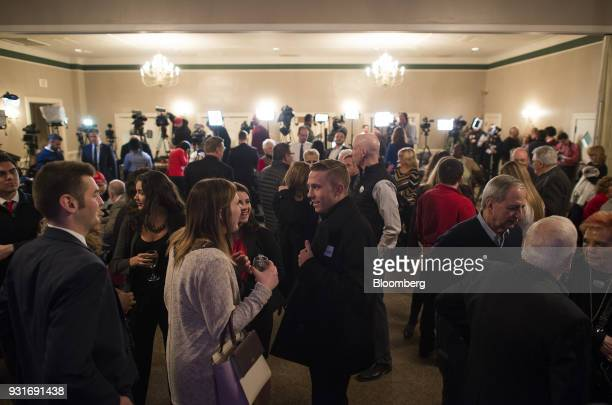 Attendees gather ahead of an election night rally with Rick Saccone Republican candidate for the US House of Representatives not pictured in...