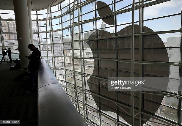Attendees gather at the Apple Worldwide Developers Conference at the Moscone West center on June 2 2014 in San Francisco California Apple CEO Tim...