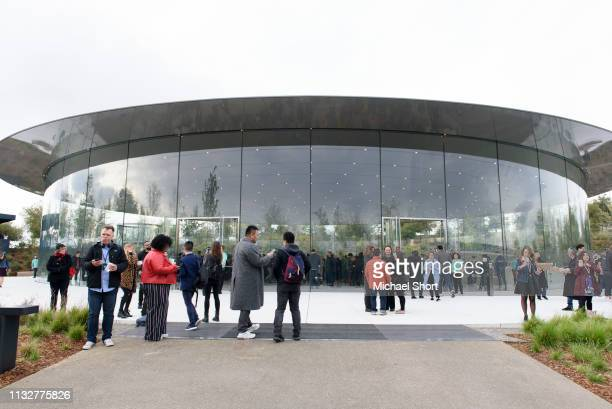Attendees gather before an Apple product launch event at the Steve Jobs Theater at Apple Park on March 25 2019 in Cupertino California Apple Inc...