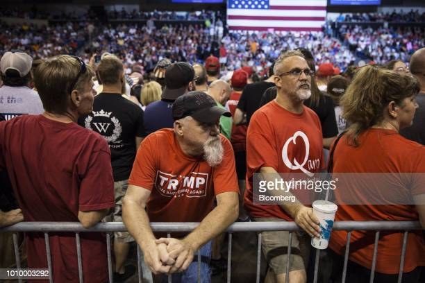 Attendees gather before the start of a rally with US President Donald Trump in WilkesBarre Pennsylvania US on Thursday Aug 2 2018 Trump tweeted...