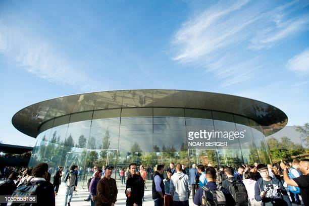 Attendees gather for a product launch event at Apple's Steve Jobs Theater on September 12 in Cupertino California New iPhones set to be unveiled...