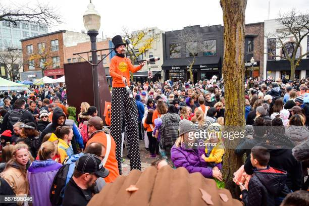 Attendees gather for the unveiling of the first exclusive samples of new Reese's Outrageous Bars at Royal Oak MichiganÕs annual Halloween...