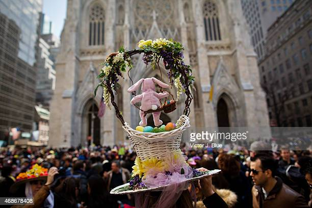 Attendees gather in front of St Patricks Cathedral along Fifth Avenue during the annual Easter Parade April 5 2015 in New York City The parade...