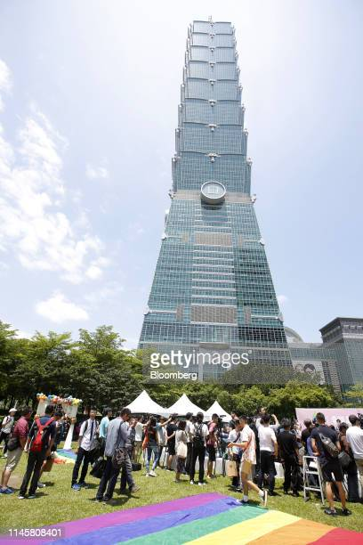 Attendees gather in front of the Taipei 101 building during a pro same-sex marriage party organized by the Taipei City government and Marriage...