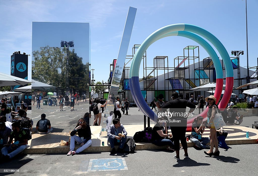 Attendees gather near a sculpture during Google I/O 2016 at Shoreline Amphitheatre on May 19, 2016 in Mountain View, California. Google CEO Sundar Pichai delivered the keynote address to kick off the annual Google I/O conference that runs through May 20.