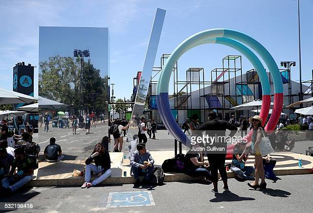Attendees gather near a sculpture during Google I/O 2016 at Shoreline Amphitheatre on May 19 2016 in Mountain View California Google CEO Sundar...