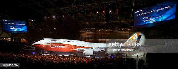 Attendees gather to view a Boeing 7478 Intercontinental the company's newest and largest passenger plane during an unveiling ceremony February 13...