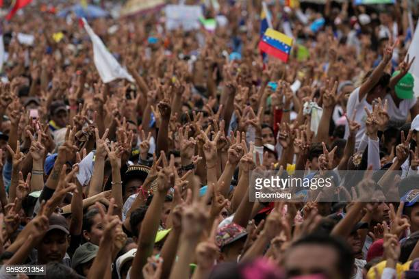 Attendees gesture peace signs during the closing campaign rally for Evangelical pastor Javier Bertucci presidential candidate for the Esperanza Por...