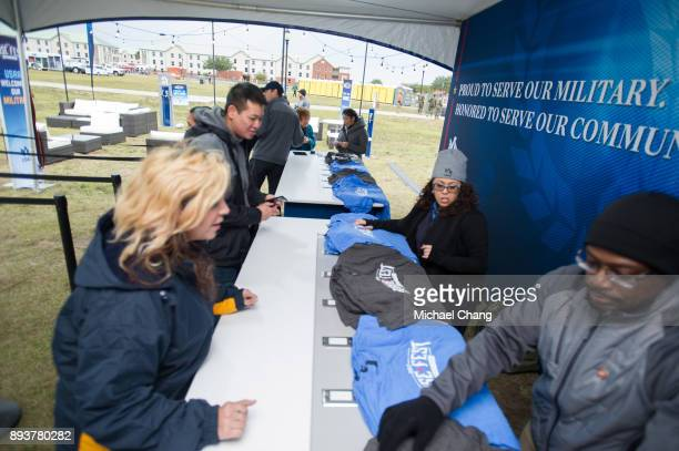 Attendees get their shirts during Base*FEST Powered by USAA on December 15 2017 at Naval Air Station Pensacola Florida