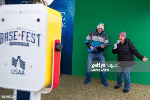 Attendees have a photo taken during Base*FEST Powered by USAA on December 15 2017 at Naval Air Station Pensacola Florida Photo by Michael Chang/Getty...
