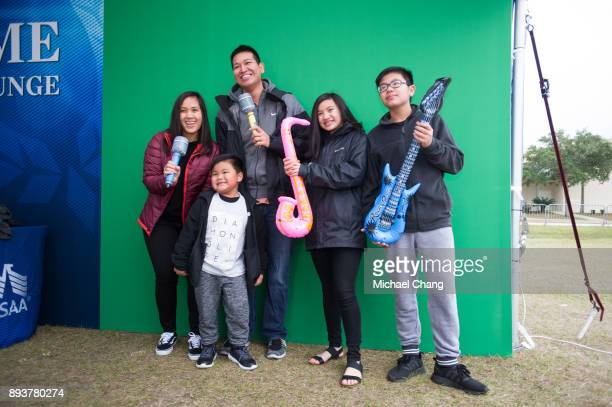 Attendees have a photo taken during Base*FEST Powered by USAA on December 15 2017 at Naval Air Station Pensacola Florida