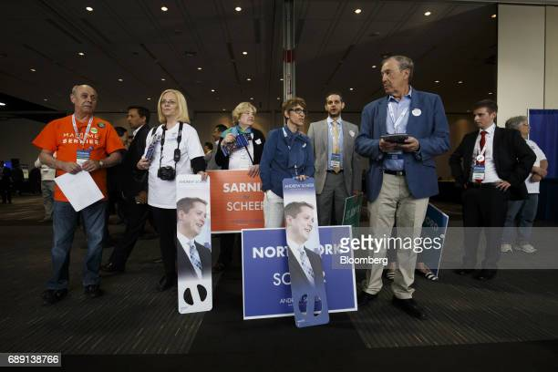 Attendees hold campaign signs for Andrew Scheer member of parliament and Conservative Party leader candidate during the Conservative Party Of Canada...
