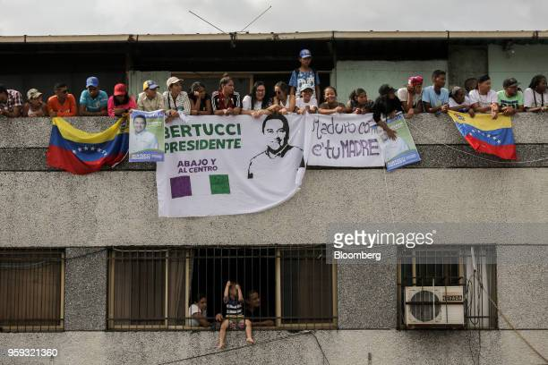 Attendees hold flags and banners during the closing campaign rally for Evangelical pastor Javier Bertucci presidential candidate for the Esperanza...