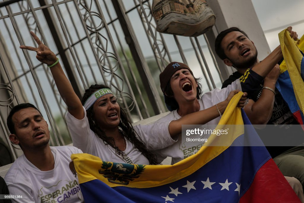 Attendees hold flags and cheer during the closing campaign rally for Evangelical pastor Javier Bertucci, presidential candidate for the Esperanza Por El Cambio (EEC) Party, in Valencia, Carabobo state, on Wednesday, May 16, 2018. Venezuelans head to the polls on May 20, as foreign leaders call for a suspension and the country's main opposition alliance shun the elections. Photographer: Manaure Quintero/Bloomberg via Getty Images
