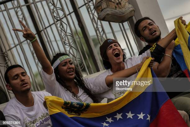 Attendees hold flags and cheer during the closing campaign rally for Evangelical pastor Javier Bertucci presidential candidate for the Esperanza Por...