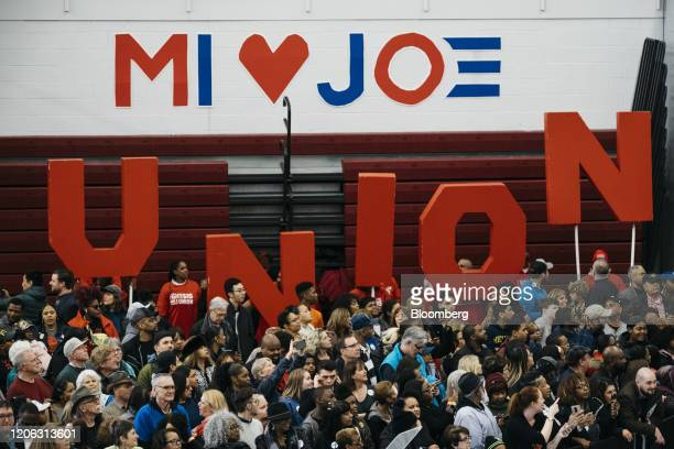 """Attendees hold giant letters spelling """"Union"""" as they wait during a campaign event with former Vice President Joe Biden, 2020 Democratic presidential..."""