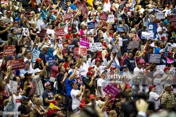Attendees hold placards and cheer during a rally with US President Donald Trump not pictured in Tampa Florida US on Tuesday July 31 2018 Iranian...