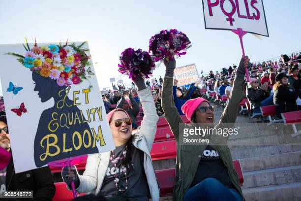 Attendees hold signs and cheer during the Women's March OneYear Anniversary Power To The Polls event in Las Vegas Nevada US on Sunday Jan 21 2018 On...