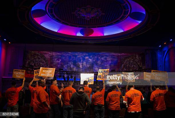 Attendees hold signs as Hillary Clinton former Secretary of State and 2016 Democratic presidential candidate not pictured speaks during a campaign...