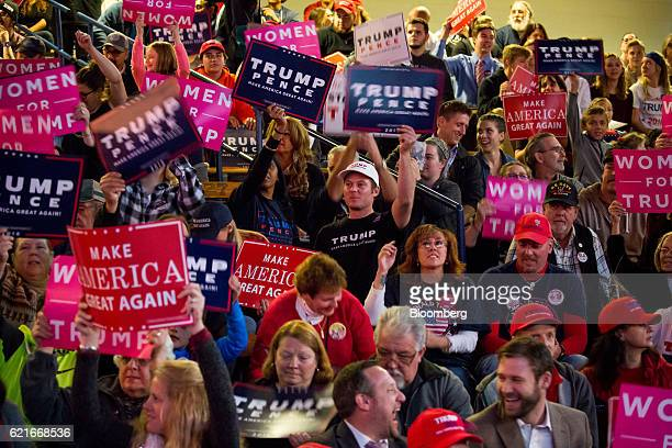 Attendees hold signs before the start of a campaign event for Donald Trump 2016 Republican presidential nominee in Scranton Pennsylvania US on Monday...