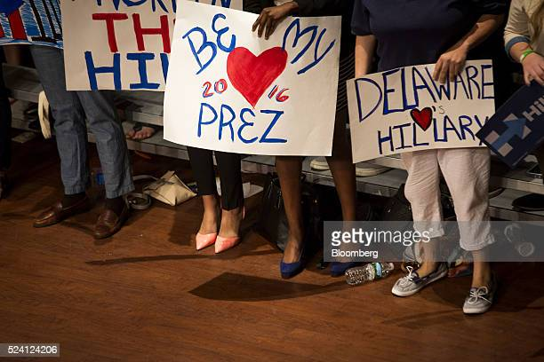 Attendees hold signs during a campaign event for Hillary Clinton former Secretary of State and 2016 Democratic presidential candidate not pictured in...