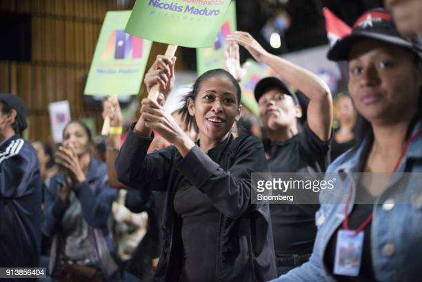 Attendees hold signs in support of Nicolas Maduro Venezuela's president not pictured during a Tupamaro political party rally n Caracas Venezuela on...
