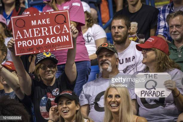 Attendees hold signs referencing the letter Q before the start of a rally with US President Donald Trump in WilkesBarre Pennsylvania US on Thursday...