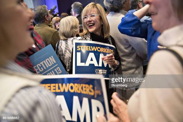 Attendees hold 'Steelworkers for Lamb' signs during an election night rally for Conor Lamb Democratic candidate for the US House of Representatives...