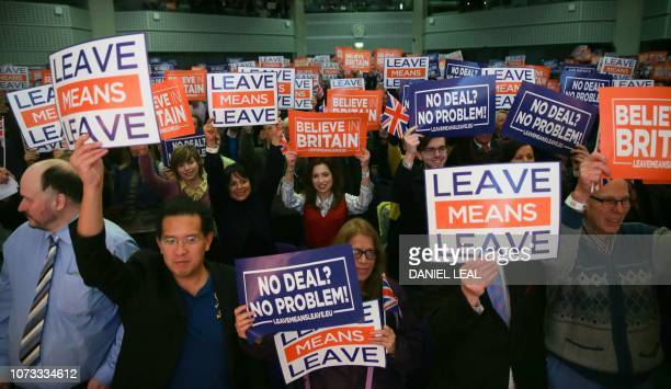 TOPSHOT Attendees hold up signs with slogans at a political rally organised by the proBrexit Leave Means Leave campaign group in central London on...