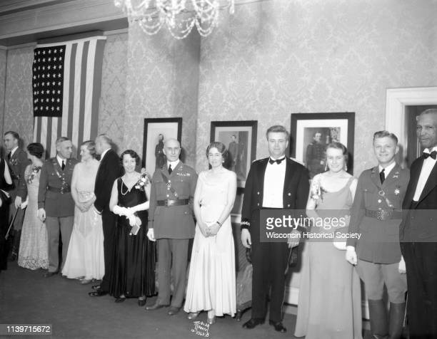 Attendees in formal wear stand in a military ball receiving line from right to left Sam Pierce Arnold H Dammen Helga Gundersen Ralph M Immell Dorothy...