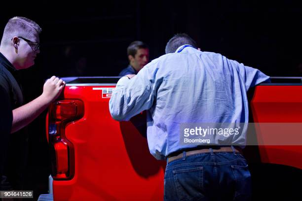 Attendees inspect a General Motors Co 2019 Chevrolet Silverado pickup truck during the 2018 North American International Auto Show in Detroit...