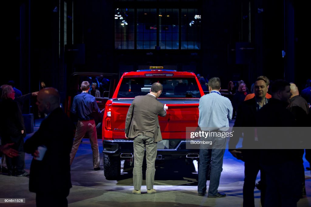 Attendees inspect a General Motors Co. (GM) 2019 Chevrolet Silverado pickup truck during the 2018 North American International Auto Show (NAIAS) in Detroit, Michigan, U.S., on Saturday, Jan. 13, 2018. GM kicked off the Detroit auto show by revealing all-new Silverado pickup truck that is the first all-new, completely-redesigned truck the automaker has sold since 2007. Photographer: Andrew Harrer/Bloomberg via Getty Images