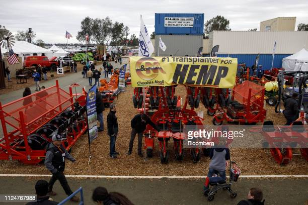 Attendees inspect Checchi Magli hemp transplanters during the World Agriculture Expo in Tulare California US on Wednesday Feb 13 2019 The annual...
