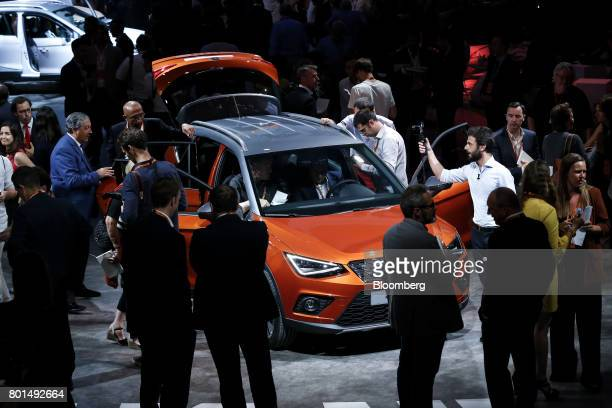 Attendees inspect the 2017 Espanola de Automovil Turismo Arona compact sports utility vehicle during a launch event in Barcelona Spain on Monday June...