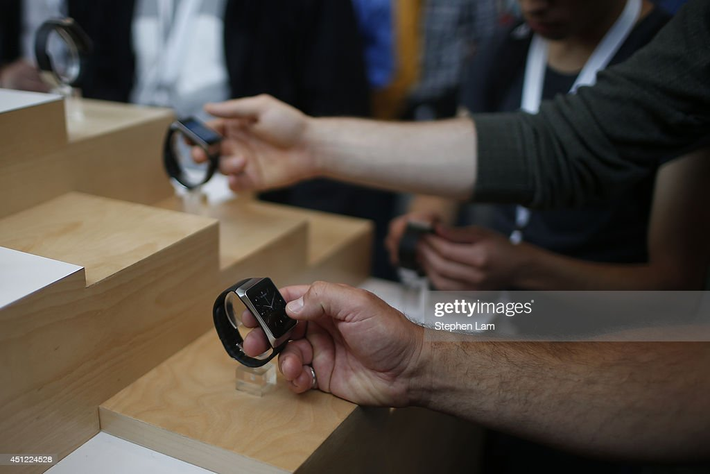 Attendees interacts with the Samsung Gear Live watch during the Google I/O Developers Conference at Moscone Center on June 25, 2014 in San Francisco, California. The seventh annual Google I/O Developers conference is expected to draw thousands through June 26.